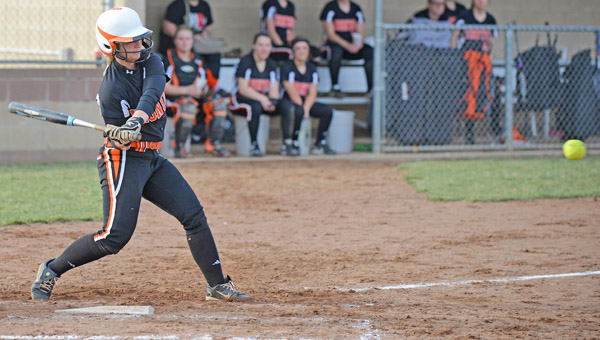 Ironton Lady Fighting Tigers' third baseman Laken White swings during a softball game. White belted a home run as the Lady Tigers outscored Portsmouth 11-9 on Tuesday. (Kent Sanborn of Southern Ohio Sports Photos)
