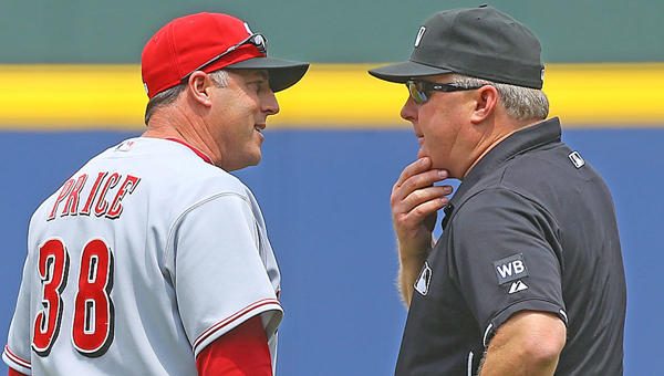 Cincinnati Reds manager Bryan Price is ejected from the game by second base umpire Bill Miller, after arguing a first base call following a review, in the first inning against the Atlanta Braves at Turner Field in Atlanta Sunday. The Braves defeated the Reds in 10 innings, 1-0. (MCT Direct Photo)