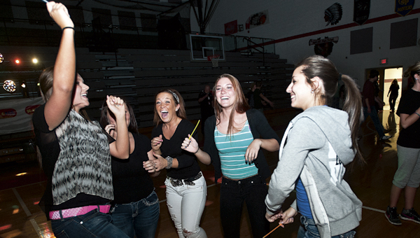 Students dance during a celebratory party sponsored by WKEE 100 FM Thursday at Rock Hill High School.