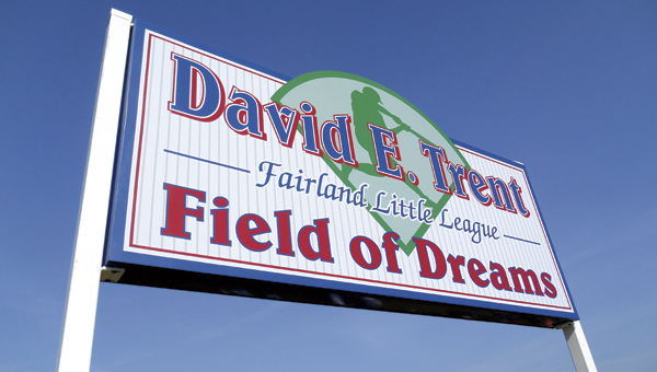 the tribune/justin prince The newly unveiled sign honoring David Trent at the Fairland Little League complex. Trent was one of the league's founding members.