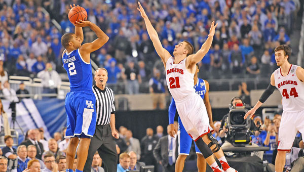 Aaron Harrison (2) shoots a three-pointer over Josh Gasser (21) of Wisconsin which becomes the winning shot in the closing seconds in the second half as the Kentucky Wildcats nipped the Wisconsin Badgers 74-73 in the second semifinal game of the Final Four at AT&T Stadium Saturday. (MCT Direct Photo)