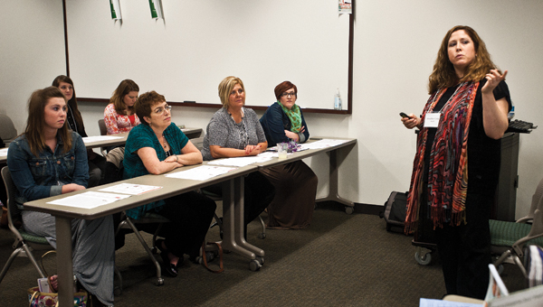 """Women gather for a workshop """"What's So Essential About Essential Oils"""" on Friday at the annual Women's Conference."""