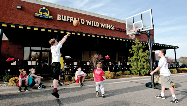 Area children make free throw shots during a promotional Gus Macker event at Buffalo Wild Wings Thursday.
