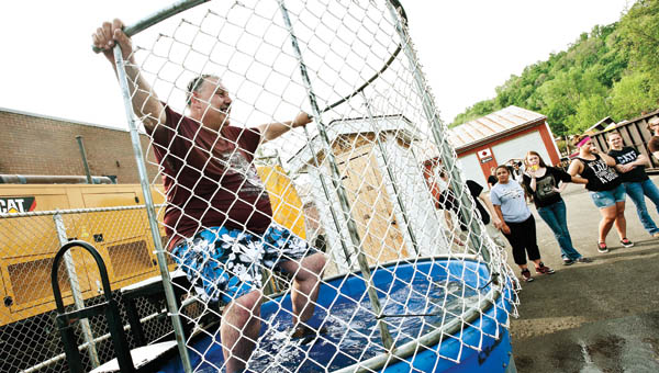Charlie Hammonds participates in the dunking booth event during the Relay for Life event at Collins Career Center Friday.