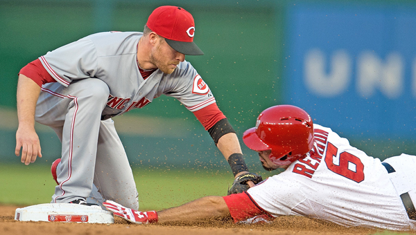 Washington Nationals third baseman Anthony Rendon (6) is tagged out at second base by Cincinnati Reds shortstop Zack Cozart (2) trying to stretch a hit into a double during the third inning of their game at Nationals Park in Washington, D.C, Monday. The Reds won 4-3 in 15 innings on Todd Frazier's two-run home run. (MCT Direct)