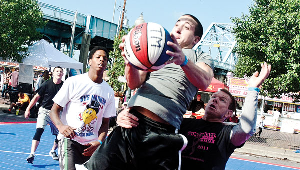 Teams compete on the top men's court Saturday in downtown Ironton during the annual Gus Macker tournament.