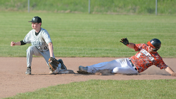 Ironton Fighting Tigers' Trevor Eastgerling (right) slides safely into second base as Coal Grove infielder Dylan Malone awaits the throw. Coal Grove rallied with a five-run fourth inning to beat the Fighting Tigers 6-3 on Wednesday. (Kent Sanborn of Southern Ohio Sports Photos)