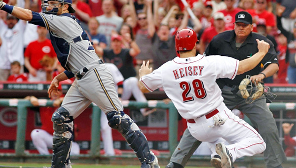 Cincinnati's Chris Heisey (28) scores the winning run in the 10th inning on Todd Frazier's double as the Reds beat the Milwaukee Brewers, 4-3, on Sunday. (Photo Courtesy of The Cincinnati Reds.com)