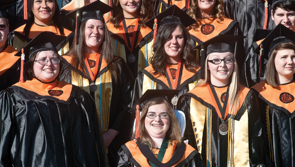 2014 graduate students from Ironton High School gather on the campus' from steps for the annual class photo before the start of commencement ceremonies Sunday evening.