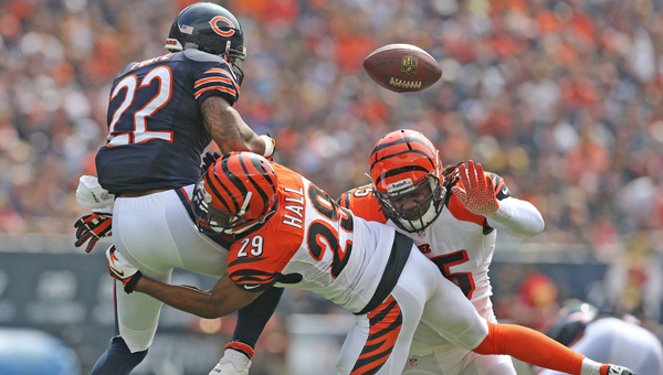Cincinnati Bengals' cornerback Leon Hall (29) breaks up a pass intended for Chicago Bears running back Matt Forte (22). Hall said he will be ready for training camp. (MCT Direct Photo)