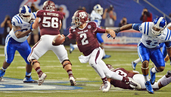 Texas A&M quarterback Johnny Manziel (2) was taken in the first round by the Cleveland Browns with the No. 22 pick. (MCT Direct Photo)