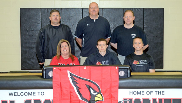 Coal Grove Hornets' All-Ohio senior basketball standout Conor Markins signed a letter-of-intent to play at Wheeling Jesuit University. Attending the signing ceremony were: seated from left to right, mother Noel Smith, Conor, and father Brad Markins; standing from left to right, Hornets' assistant coach Kevin Vanderhoof, Hornets' head coach Jay Lucas and Hornets' assistant coach John Large. (Kent Sanborn of Southern Ohio Sports Photos)