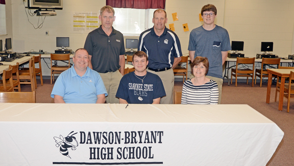 Coal Grove Hornets' senior golfer Luke McGraw signed a letter-of-intent to play for the Shawnee State Golden Bears. Attending the signing ceremony were: seated from left to right, father Ron McGraw, Luke, and mother Linda McGraw; standing from left to right, Hornets' coach Danny Morgan, Shawnee State assistant coach Dave Hopkins and brother Zach McGraw. (Kent Sanborn of Southern Ohio Sports Photos)
