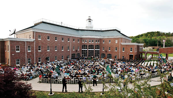 Friends and family gather in the courtyard at OUS for the graduate recognition ceremony.