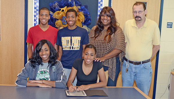 South Point Lady Pointers' senior volleyball standout Tia Pettigrew signed a letter-of-intent to play at University of Northwester Ohio. Attending the ceremony were: seated from left to right, sister Tyra Pettigrew and Tia; standing from left to right, brothers Trey Patterson and Trent Patterson, Pettigrew, mother Melanee Keys and step-father Randy Hagans. (Kent Sanborn of Southern Ohio Sports Photos)