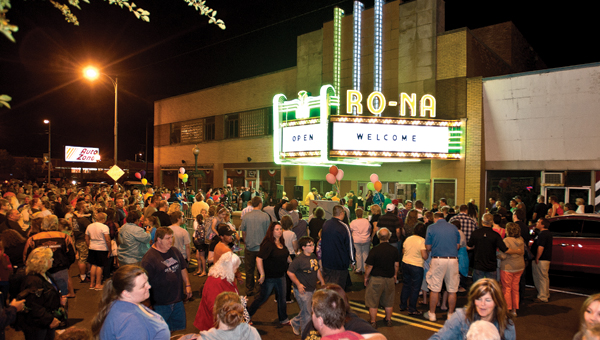 A crowd gathers outside the Ro-Na Theatre for the lighting of the marquee Friday.