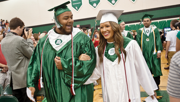Graduates from Fairland High School are excited as they participate in the processional at the start of commencement exercises Friday.