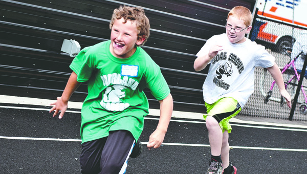 Donnie Nolan, a student at Fairland schools, becomes very excited as he passes his competitor during the boys 50-meter dash event at the Lawrence County Special Olympics event Tuesday in Chesapeake.