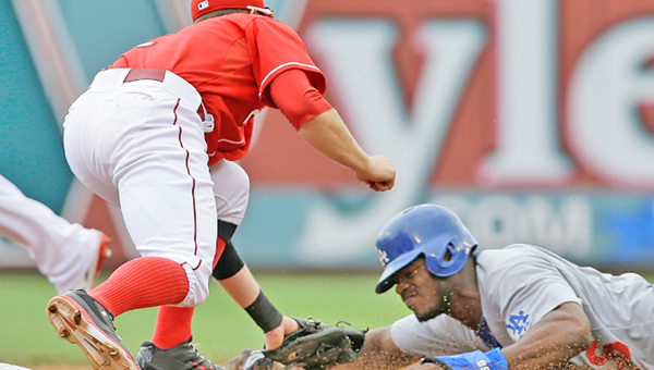 Cincinnati shortstop Zack Cozart tags out Los Angeles' Yasiel Puig trying to steal second base during Thursday's game. The Reds beat the Dodgers 4-1 as Cozart extended his hitting streak to seven games. (Photo Courtesy of the Cincinnati Reds.com)