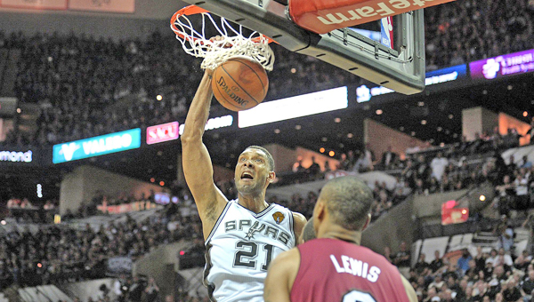 The San Antonio Spurs' Tim Duncan scores in front of the Miami Heat's Rashard Lewis (9) during Game 1 of the NBA Finals on Thursday. Duncan had 21 points and 10 rebounds in a 110-95 win. (MCT DIRECT PHOTO)