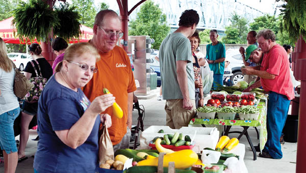 Visitors browse through produce and wares at the Ironton Farmers Market Saturday.