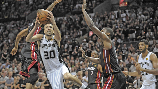 San Antonio Spurs guard Manu Ginobili drives past Miami Heat's Rashard Lewis and Chris Bosh during the first half in Game 5 of the NBA Finals at the AT&T Center in San Antonio, Texas, on Sunday.The Spurs won 104-87 to win their fifth NBC title. (MCT Direct Photo)