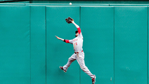 Cincinnati centerfielder Billy Hamilton makes a leaping catch in the ninth inning. Despite the play, the Reds lost to the Pittsburgh Pirates 4-3 in 12 innings. (Courtesy of The Cincinnati Reds.com)
