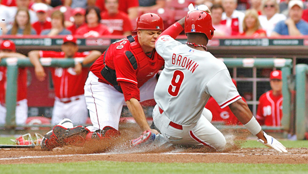 Cincinnati Reds' catcher Devin Mesoraco (left) tags out Domonic Brown (9) at home in the fourth inning of Sunday's game. The Reds beat the Philadelphia Phillies 4-1. (Courtesy of The Cincinnati Reds.com)