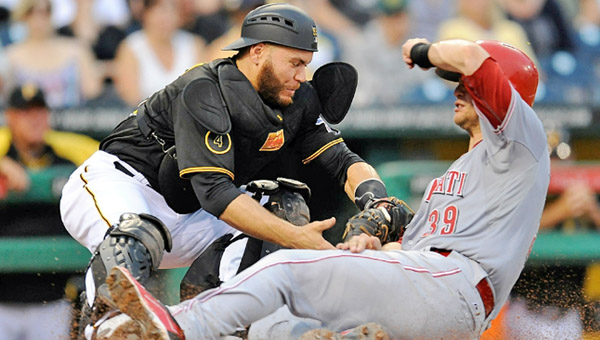 Cincinnati's Devin Mesoraco (right) slides safely into home plate ahead of the tag by Pittsburgh catcher Russell Martin to score a run during a big third inning on Wednesday. The Reds beat Pittsburgh 11-4. (Photo Courtesy of The Cincinnati Reds.com)