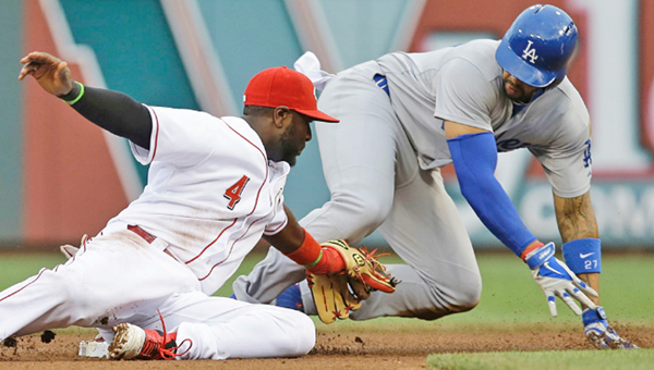 Cincinnati Reds' second baseman Brandon Phillips (left) applies a tag late as Los Angeles Dodgers' Matt Kemp slides into second base with a double. The Dodgers beat the Reds 6-2. (Photo Courtesy of The Cincinnati Reds.com)