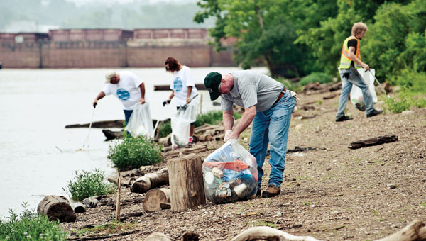 Local volunteers clean up the South Point boat ramp during the annual River Sweep Saturday.