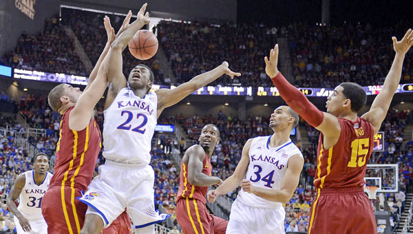 Kansas' Andrew Wiggins (22) is fouled as he drives to the basket. Wiggins could be the top pick in the NBA draft on Thursday. (MCT Direct Photo)