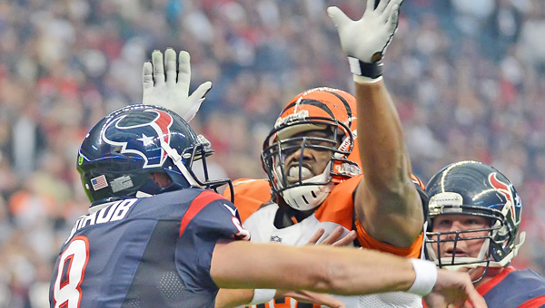 Geno Atkins (97) of the Cincinnati Bengals pressures Matt Schaub (8) of the Houston Texans. Atkins was placed on the physically unable to perform list Monday along with cornerback Leon Hall and seven other players. (MCT Direct Photo)