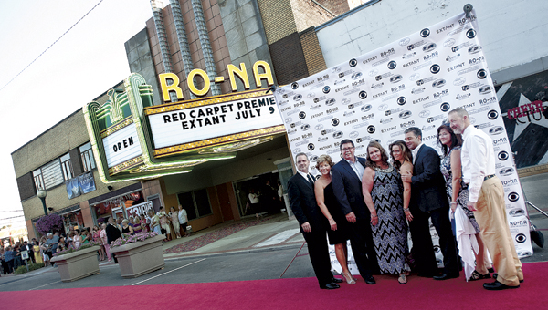 """VIPs pose for pictures outside of the Ro-Na Theater before the premiere of Ironton native Mickey Fisher's show """"Extant."""""""