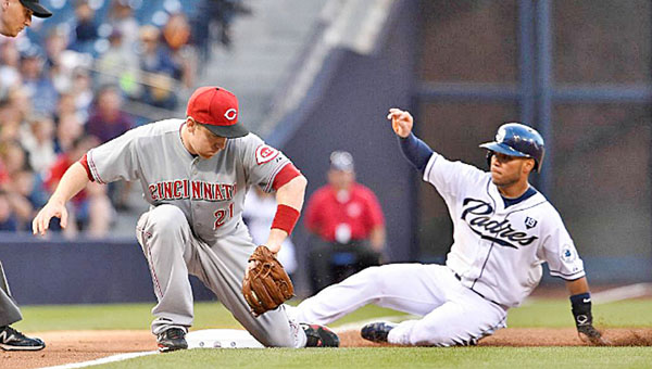 Cincinnati third baseman Todd Frazier can't get the tag in time for the out on San Diego's Alexi Amarista (right) as he slides safely into the base during a play in the second inning. San Diego beat the Reds 8-2 on Tuesday. (Courtesy of The Cincinnati Reds.com)
