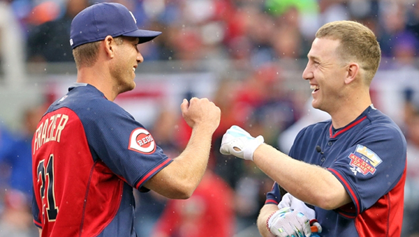 Cincinnati Reds' Todd Frazier (right) fist bumps with his brother, Charlie, who was his pitcher in the annual All-Star Game Home Run Derby on Monday. Frazier finished second. (MCT Direct Photo)