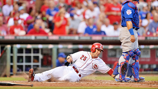 Skip Schumaker slides safely into home plate as he scores a run in the Cincinnati Reds 4-1 win over the Chicago Cubs on Wednesday. (Courtesy of the Cincinnati Reds.com)