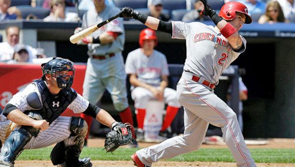 Cincinnati Reds' second baseman Skip Schumaker — just off the disabled list — doubles home Zack Cozart in the fifth inning of Sunday's game. Schumaker's RBI wasn't enough as the Reds lost to the New York Yankees 3-2. (Courtesy of The Cincinnati Reds.com)