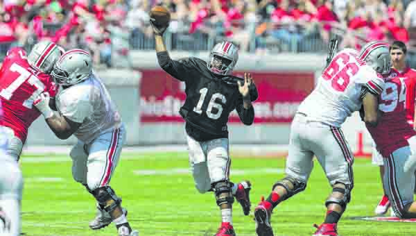 Redshirt freshman quarterback J.T. Barrett will be the main focus as the Ohio State Buckeyes open the season at Navy on Saturday. Barrett takes over for injured starter Braxton Miller who is out for the season.