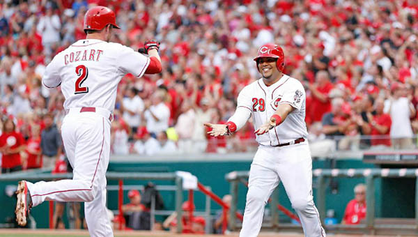 Cincinnati shortstop Zack Cozart (2) is congratulated by Brayan  Pena after he belted a three-run homer in the second inning to help the Reds beat the Cleveland Indians 8-3 Wednesday. (Courtesy of the Cincinnati Reds.com)