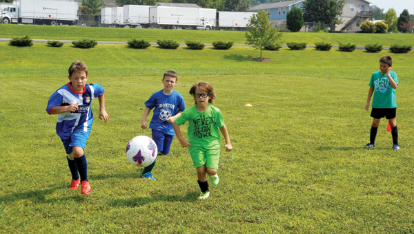 Local children participate in a World Cup soccer tournament.