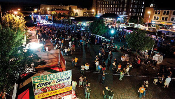 Eventgoers gather on the Rally grounds at the annual Rally on the River in downtown Ironton.
