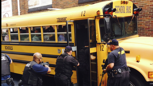 submitted Members of the Lawrence County Sheriff's Office Special Weapons and Tactics (SWAT) team and the Ironton Police Department participate in a bus driver training scenarios with all county bus drivers. The purpose of the training was to make bus drivers aware of police actions during a possible hostage or active shooter situation on a school bus.