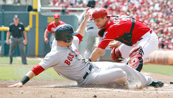 Cincinnati Reds' catcher Devin Mesoraco (right) can't get the tag down in time to get the sliding Mike Napoli who came home to score in the first inning Mike Napoli hit into a fielder's choice. (Photo courtesy of The Cincinnati Reds.com)