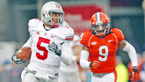 Ohio State Buckeyes' quarterback Braxton Miller (5) — the two-time Big Ten Offensive Player of the Year — reinjured his shoulder on Monday and his status is uncertain. (MCT Direct Photo)