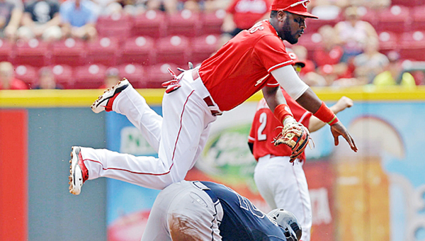 Cincinnati Reds' second baseman Brandon Phillips gets the force out at second base despite a sliding Jason Heyward during the first inning of Sunday's game. The Reds won 5-3. (MCT Direct Photos)