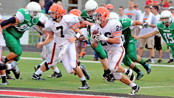Ironton Fighting Tigers' running back Tanner Price (26) follows the lead block of quarterback Jake Isaac (7) during last week's scrimmage against Coal Grove. Ironton opens the season at Wheelersburg on Friday. (Kent Sanborn of Southern Ohio Sports Photos)