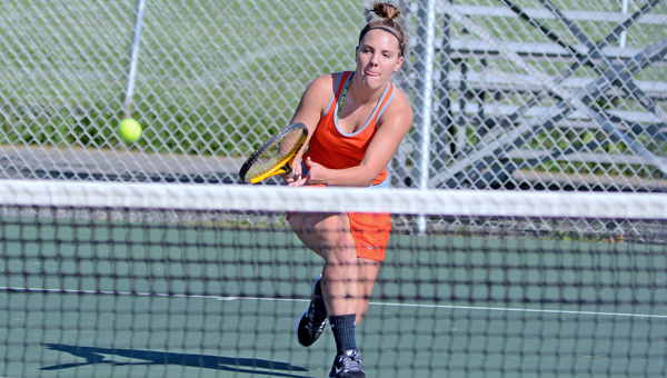 Ironton Lady Fighting Tigers' senior Ariel Whitt uses a backhand swing to return a volley during a tennis match on Thursday. Jackson rallied in the final match to beat Ironton 3-2. (Kent Sanborn of Southern Ohio Sports Photos)