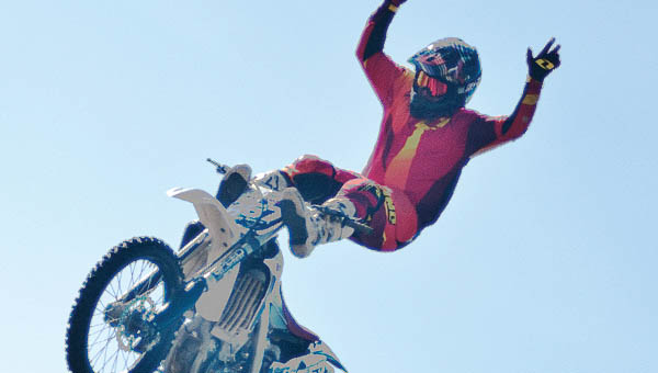 Ray Roehlk performs a freestyle trick at an exhibition during Rally on the River.