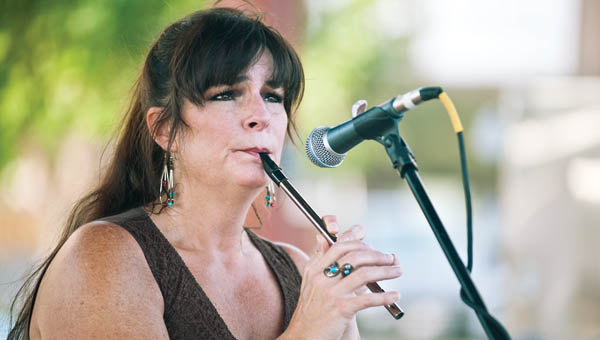 Karen Byington, with the duo Wiley Dew, plays a piccolo during the summer Ironton concert series at the Farmers Market on Tuesday.